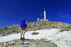 Hiker with big traveling rucksack looking forward on the mountai Royalty Free Stock Photos