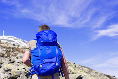 Hiker with big traveling rucksack looking forward on the mountain Royalty Free Stock Image