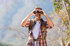 Hiker binoculars mountain Stock Images
