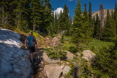 Hiker on a Blue Lake Trail Colorado Royalty Free Stock Photography