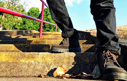 Hiker boots climbing high steps royalty free stock photography