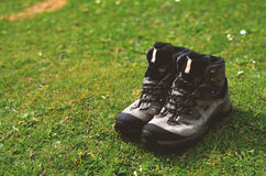 Hiker boots at the grass. In mountains Stock Images