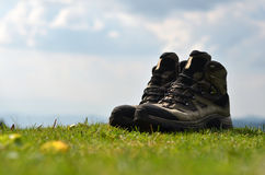 Hiker boots at the grass stock images