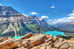 Hiker on Bow Summit overlooking Peyto Lake in Banff National Par stock photography