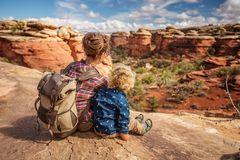Hiker with boy in Canyonlands National park, needles in the sky, in Utah, USA royalty free stock photo