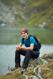 Hiker boy by the lake Stock Images