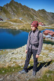 Hiker boy by the lake Royalty Free Stock Photo