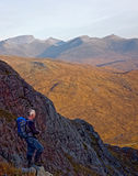 Hiker on Buachaille Etive Mor. With Ben Nevis in the background Royalty Free Stock Photos