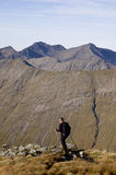 Hiker on Buachaille Etive Mor. With Bidean nan Bian in the background Royalty Free Stock Photography