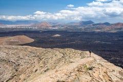 Hiker on Caldera Blanca, old volcano in Lanzarote, Canary islands Spain. Hiker on Caldera Blanca, old volcano in Lanzarote, Canary islands, Spain Stock Photography
