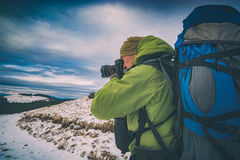 Hiker with a camera and big backpack. Instagram stylization stock photos