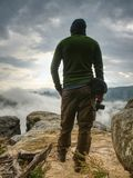 Hiker with camera in hands. Photographer takes fall photos stock photo