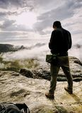 Hiker with camera in hands. Photographer takes fall photos stock photos