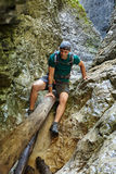 Hiker in a canyon Stock Images