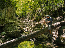 Hiker in the canyon of mountain river. Young male hiker in the canyon of mountain river Royalty Free Stock Images