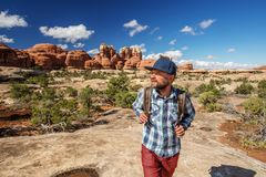Hiker in Canyonlands National park, needles in the sky, in Utah, USA stock image