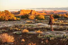 Hiker in Canyonlands National park, needles in the sky, in Utah, USA royalty free stock photos