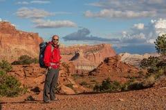 Hiker in Capitol reef National park in Utah, USA royalty free stock image