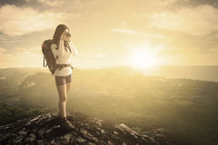 Hiker captures photo on mountain Royalty Free Stock Photos