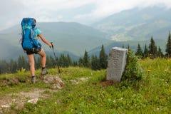 Hiker in Carpathian mountains Stock Photo