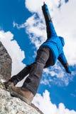 Hiker catching balance on mountain ridge Stock Photos