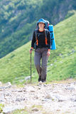 Hiker in Caucasus mountains Royalty Free Stock Photo