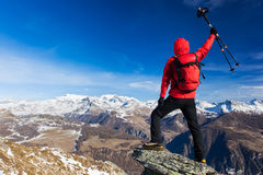 Hiker celebrates the conquest of the summit. Concepts: victory, Stock Photo