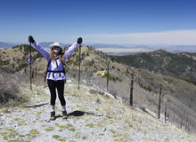 A Hiker Celebrates Reaching the Summit of a Mountain Stock Images