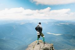 hiker celebrating success on top of a mountain stock image
