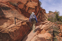 Hiker on a chain assisted trail Stock Photography