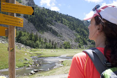 Hiker checking the direction in the sign Royalty Free Stock Image
