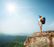 Hiker on the cliff Royalty Free Stock Photos