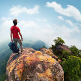 Hiker on the cliff Stock Photography
