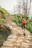 Hiker climb the stairs Royalty Free Stock Photo