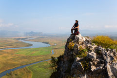Hiker climbed a mountain and admire nature Stock Photos