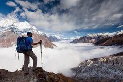 Hiker is climbig to Manaslu base camp in highlands of Himalayas Stock Photo