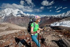Hiker is climbig to Manaslu base camp in highlands of Himalayas Stock Image