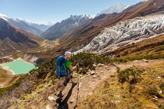 Hiker is climbig to Manaslu base camp in highlands of Himalayas Stock Photos
