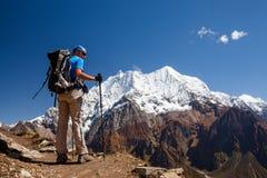 Hiker is climbig to Manaslu base camp in highlands of Himalayas Royalty Free Stock Photos