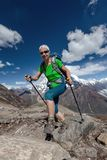 Hiker is climbig to Manaslu base camp in highlands of Himalayas Royalty Free Stock Photo