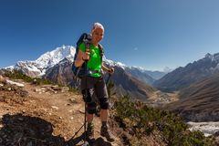 Hiker is climbig to Manaslu base camp in highlands of Himalayas Stock Images