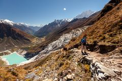 Hiker is climbig to Manaslu base camp in highlands of Himalayas Royalty Free Stock Images