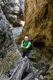Hiker climbing in a canyon Royalty Free Stock Images