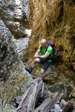 Hiker climbing in a canyon Royalty Free Stock Image