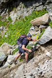 Hiker climbing the mountain Stock Image