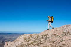 Hiker is climbing mountain Royalty Free Stock Photo