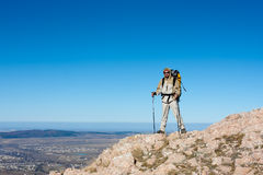 Hiker is climbing mountain Stock Images