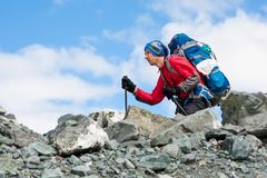 Hiker is climbing rocky slope of mountain in Altai mountains, Ru. Ssia Royalty Free Stock Images