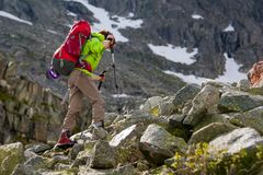 Hiker is climbing rocky slope of mountain in Altai mountains, Ru. Ssia Stock Photography
