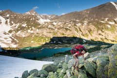 Hiker is climbing rocky slope of mountain in Altai mountains, Ru. Ssia Stock Images